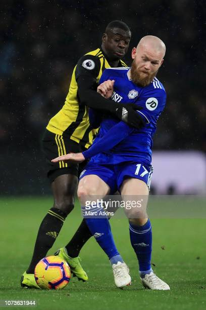 Aron Gunnarsson of Cardiff City is challenged by Ken Sema of Watford during the Premier League match between Watford FC and Cardiff City at Vicarage...