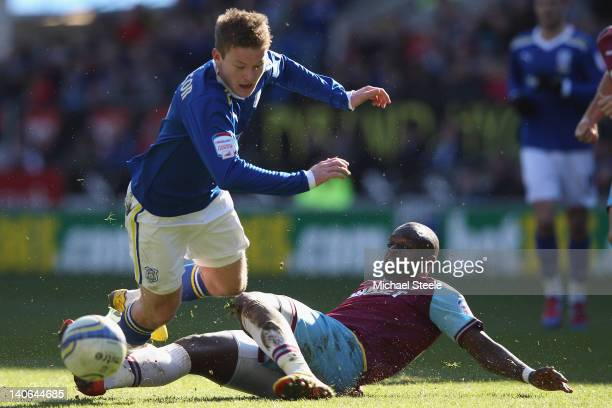 Aron Gunnarsson of Cardiff City is tackled by Abdoulaye Faye of West Ham United during the npower Championship match between Cardiff City and West...