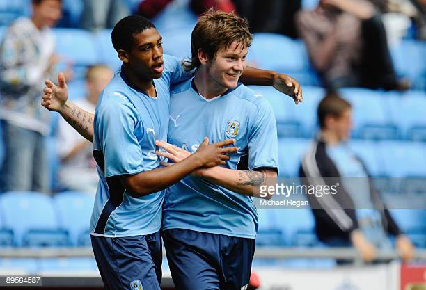 Aron Gunnarsson of Coventry celebrates his late equaliser with team mate Shaun Jeffers during the pre season friendly match between Coventry City and...