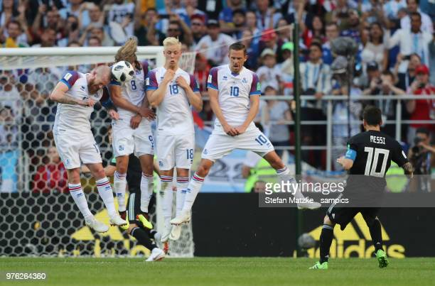 Aron GUNNARSSON of Iceland Birkir BJARNASON of Iceland Hordur MAGNUSSON of Iceland Gylfi SIGURDSSON of Iceland Lionel Messi of Argentina during the...