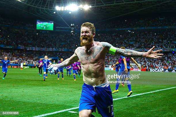 Aron Gunnarsson of Iceland celebrates at the end of the match during the European Championship match Round of 16 between England and Iceland at...