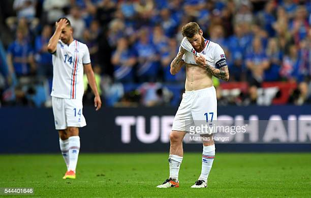 Aron Gunnarsson of Iceland reacts after France's fourth goal during the UEFA EURO 2016 quarter final match between France and Iceland at Stade de...