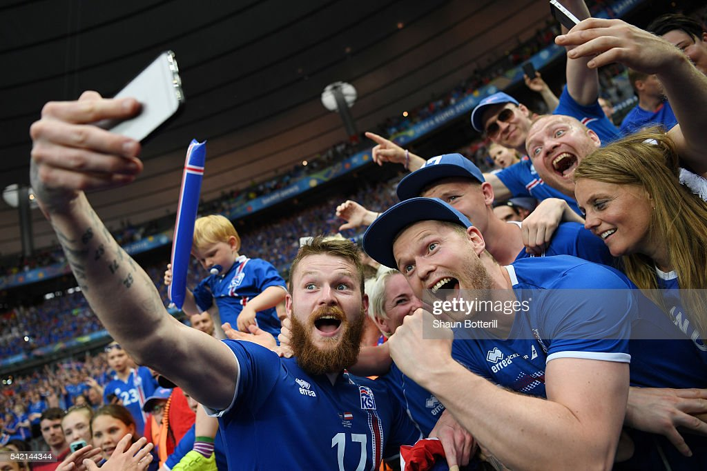 Aron Gunnarsson of Iceland takes a selfie photographs with supporters to celebrate his team's 2-1 win after the UEFA EURO 2016 Group F match between Iceland and Austria at Stade de France on June 22, 2016 in Paris, France.
