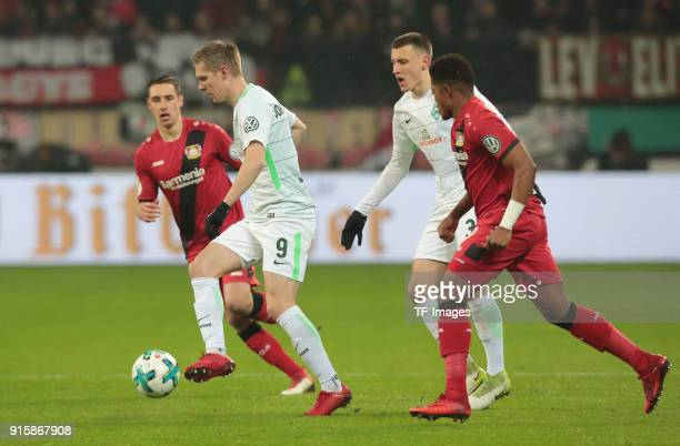 Aron Johannsson of Bremen Leon Bailey of Leverkusen and Dominik Kohr of Leverkusen battle for the ball during the DFB Cup match between Bayer...