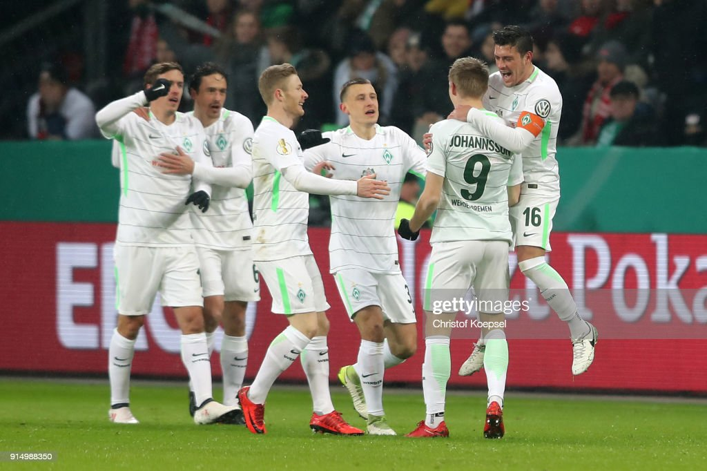 Aron Johansson of Bremen (2nd R) celebrates the second goal with his team mates during the DFB Cup quarter final match between Bayer Leverkusen and Werder Bermen at BayArena on February 6, 2018 in Leverkusen, Germany.