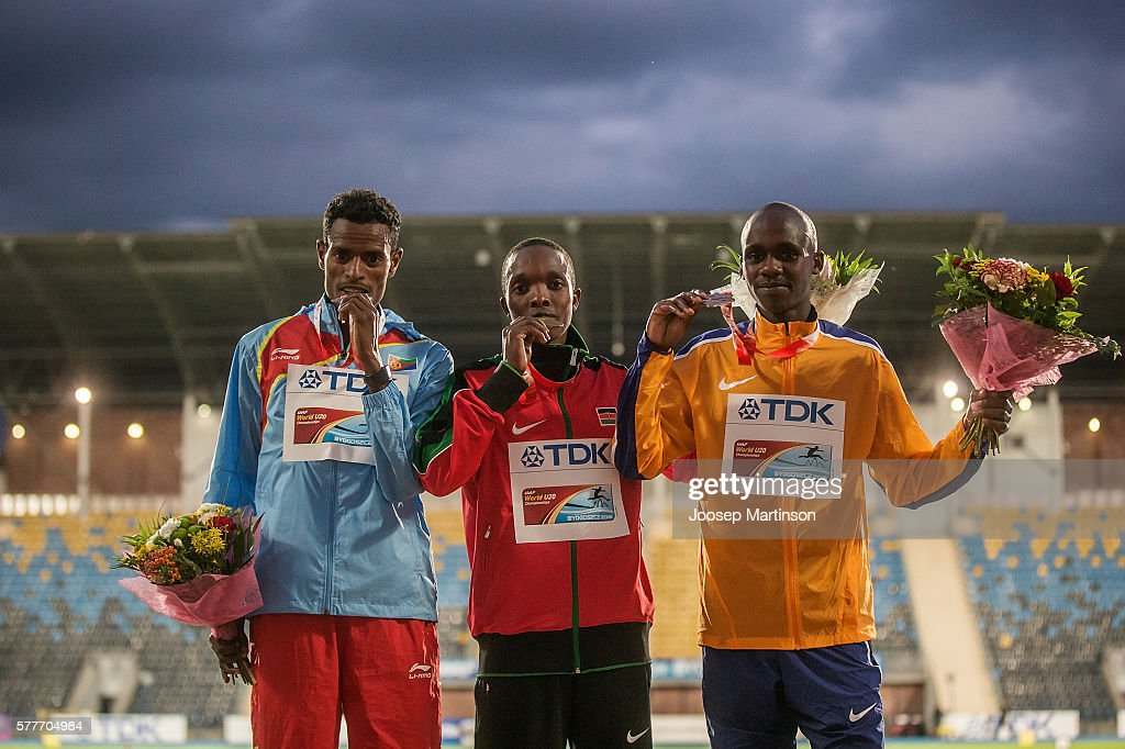 Aron Kifle from Eritrea, Rodgers Chumo Kwemoi from Kenya and Jacob Kiplimo from Uganda celebrate on the podium after men's 10000 meters final during the IAAF World U20 Championships at the Zawisza Stadium on July 19, 2016 in Bydgoszcz, Poland.