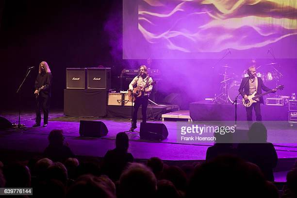Aron Strobel, Tim Wilhelm and Michael Kunzi of the German band Muenchener Freiheit perform live during a concert at the Friedrichstadtpalast on...