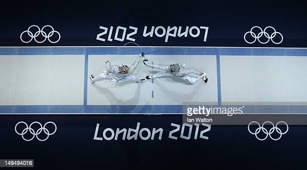 Aron Szilagyi of Hungary against Diego Occhiuzzi of Italy in the gold medal match of the Men's Sabre Individual on Day 2 of the London 2012 Olympic...