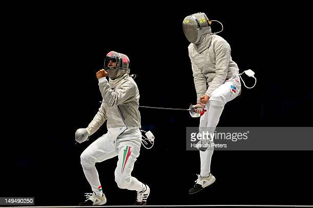 Aron Szilagyi of Hungary and Nikolay Kovalev of Russia reacts after a point during their Men's Sabre Individual semifinal match on Day 2 of the...