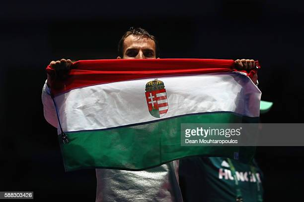 Aron Szilagyi of Hungary celebrates victory against Daryl Homer of the United States in the men's individual sabre gold medal bout on Day 5 of the...