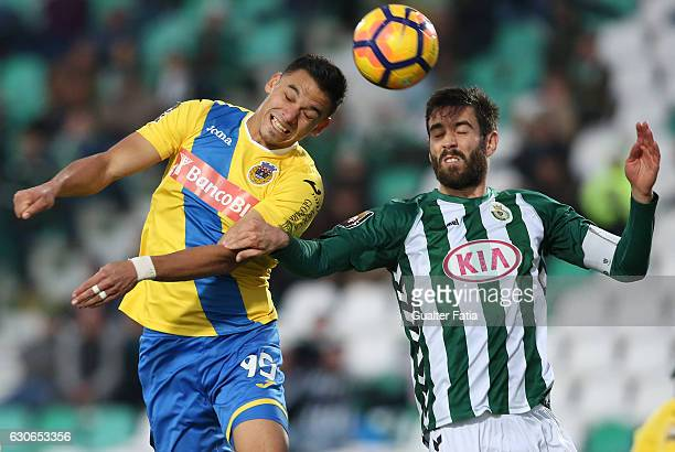 Arouca forward from Brazil Bruno Lopes with Vitoria de Setubal defender Frederico Venancio in action during Portuguese League Cup match between...