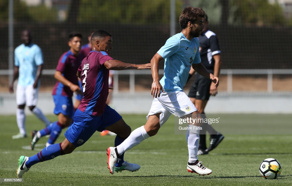 FC Arouca midfielder Andre Santos from Portugal with CD Cova da Piedade midfielder Soares from Brazil in action during the Segunda Liga match between CD Cova da Piedade and FC Arouca at Estadio Municipal Jose Martins Vieira on August 19, 2017 in Almada, Portugal.