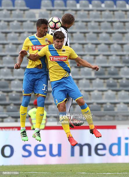 Arouca's defender Jubal Junior and Arouca's defender Hugo Basto vies with Heracles's midfielder Robin Gosens during the match between Arouca v...