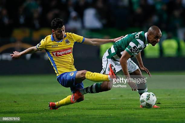 Arouca's forward Ivo Rodrigues vies for the ball with Sporting's midfielder Joao Mario during the Portuguese League football match between Sporting...