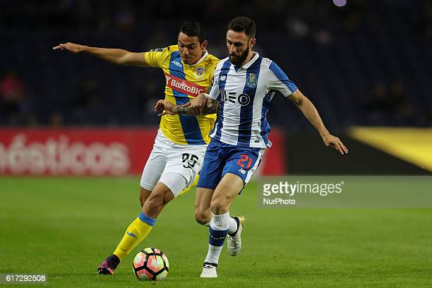 Arouca's forward Walter Gonzalez with Porto's Mexican defender Miguel Layun during Premier League 2016/17 match between FC Porto and FC Arouca at...