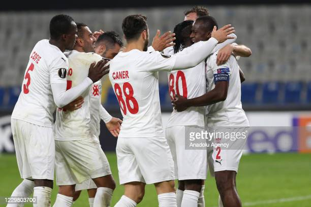 Arouna Kone of Demir Grup Sivasspor celebrates with his teammates after scoring a goal during the UEFA Europa League Group I soccer match between...