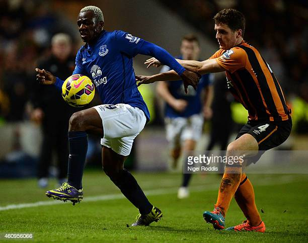 Arouna Kone of Everton challenged by Alex Bruce of Hull City during the Barclays Premier League match between Hull City and Everton at KC Stadium on...