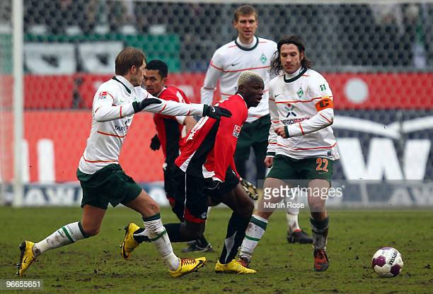 Arouna Kone of Hannover 96 and Aaron Hunt of Bremen compete for the ball during the Bundesliga match between Hannover 96 and SV Werder Bremen at the...