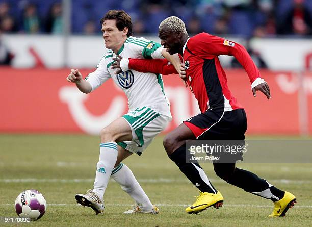 Arouna Kone of Hannover and Sascha Riether of Wolfsburg compete for the ball during the Bundesliga match between Hannover 96 and VfL Wolfsburgat...