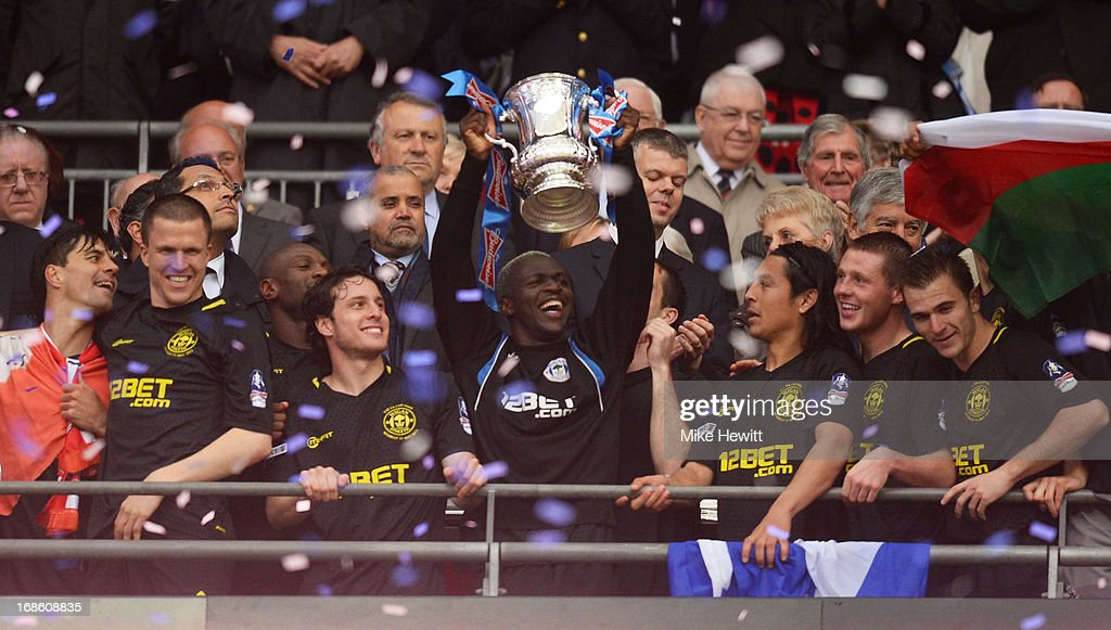 Arouna Kone of Wigan Athletic lifts the trophy after the FA Cup with