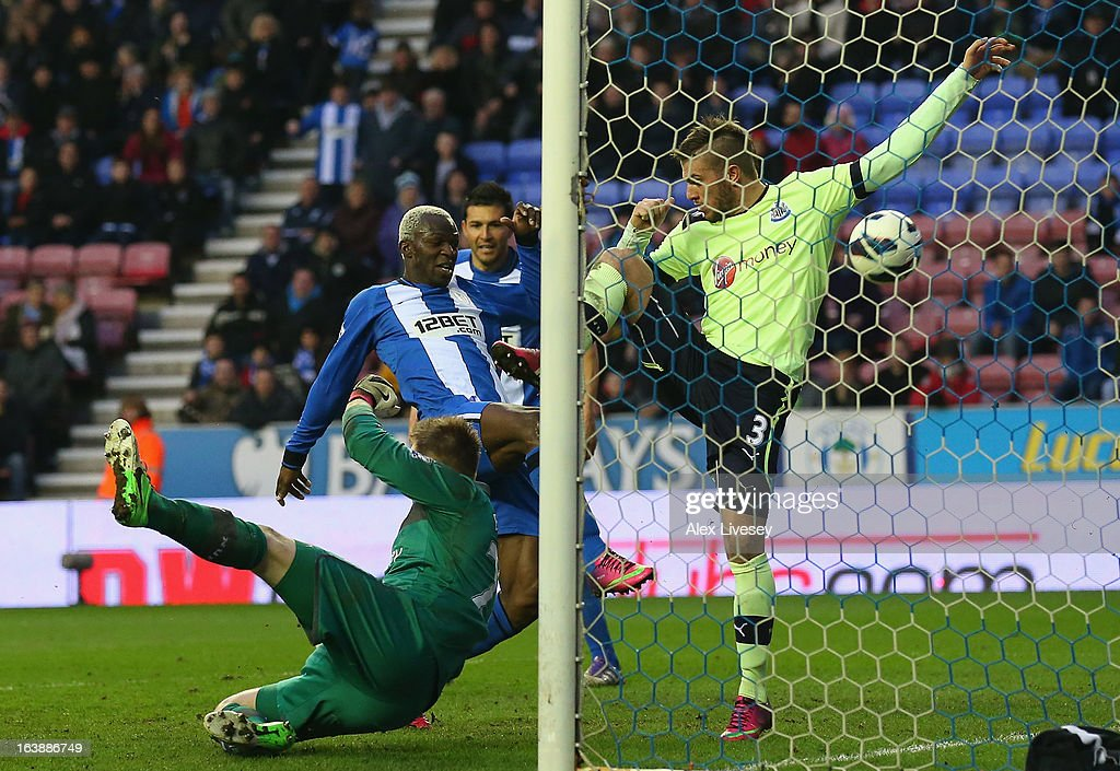 Arouna Kone of Wigan Athletic scores the winning goal during the Barclays Premier League match between Wigan Athletic and Newcastle United at the DW Stadium on March 17, 2013 in Wigan, England.
