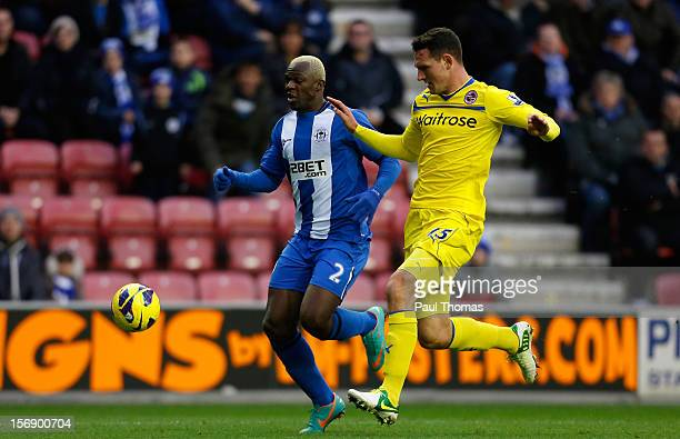 Arouna Kone of Wigan in action with Sean Morrison of Reading during the Barclays Premier League match between Wigan Athletic and Reading at the DW...