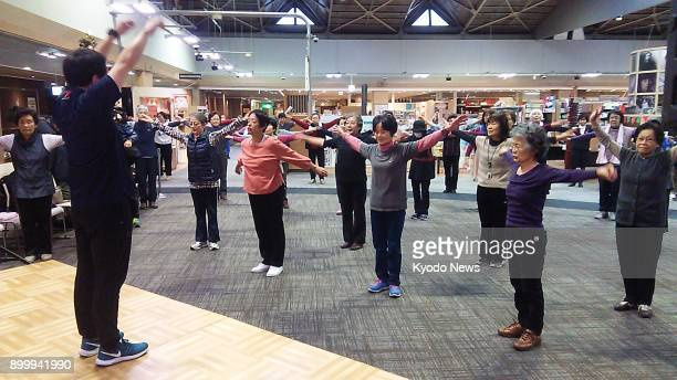 Around 100 elderly people participate in group exercises Nov 15 at a Tokyo shopping mall run by Aeon Retail Co the core arm of Japan's...