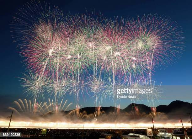 Around 18000 fireworks are shot off during the 91st national competition on Aug 26 in the northeastern Japan city of Daisen After torrential rains...