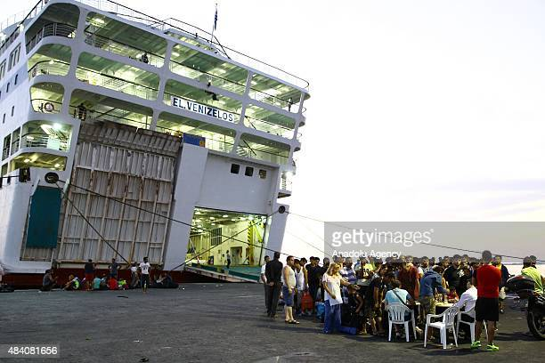 Around 1900 Syrian refugees wait outside Anek Lines' passenger ship 'Eleftherios Venizelos' in Greek Island of Kos on August 15 2015 The cruise ship...