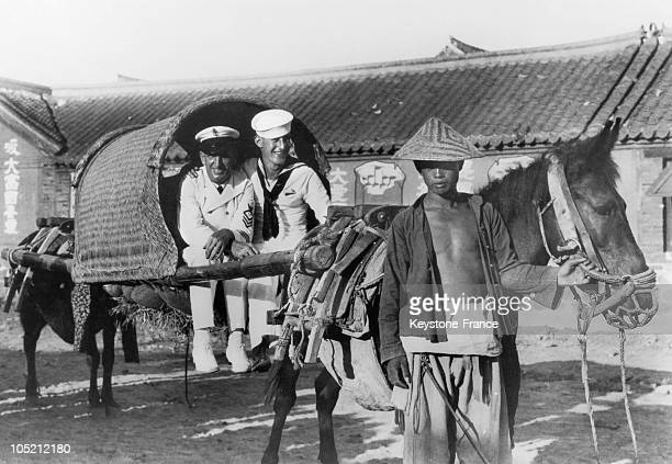 Around 1930 American Sailors On A SedanChair Carried By Two Mules Are Visiting The Picturesque Villages Of The Peninsula Of Shantung In The North Of...