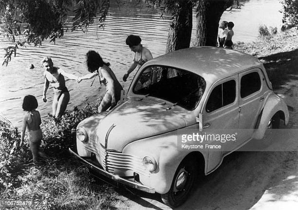 Around 1946 The 4Cv Renault Was Used By This Family To Go For A Swim In A River