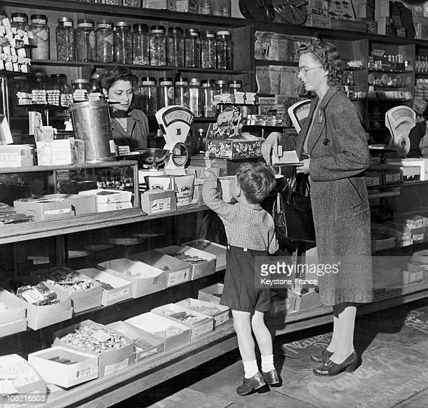 Around 19461947 This Young English Boy Discovers A Recently ReStocked Candy Store After 6 Years Of War As He Is Very Young He Has Never Known Such...