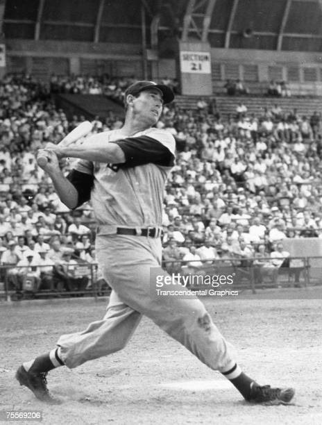 UNKNOWN C1952 Around 1952 in an unknown ballpark Ted Williams takes a huge swing before a large crowd