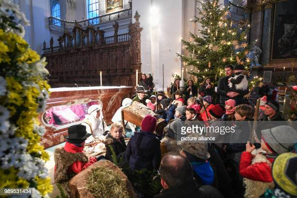 Around 20 children reenact the birth of Jesus Christ during the family church service on Christmas Eve at the Basilica in Weingarten Germany 24...