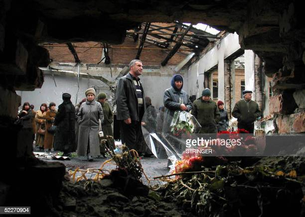 Around 200 friends and relatives of victims killed in the Beslan school hostage massacre gather 03 March 2005 in the remains of the school in Beslan...