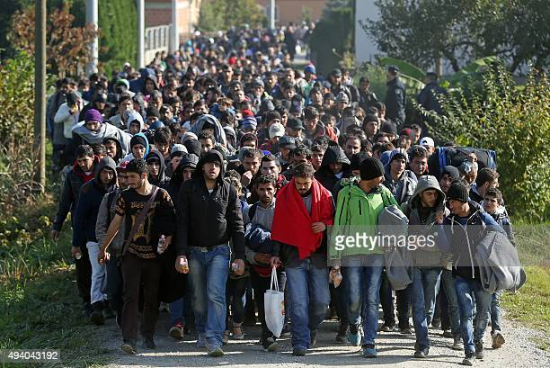 Around 2000 migrants who arrived by train, walk near the border town of Kljuc Brdovecki, on October 24 to cross the Croatia-Slovenia border. Crowds...