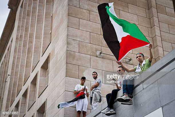 Around 2000 people gathered in Brussels to show support to people in Palestine Protesters holding a Palestinian flag during the protest