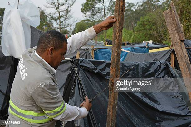 Around 2500 families associated with Brazil's Homeless Workers' Movement live in a makeshift campsite close to Sao Paulo's World Cup stadium Arena...
