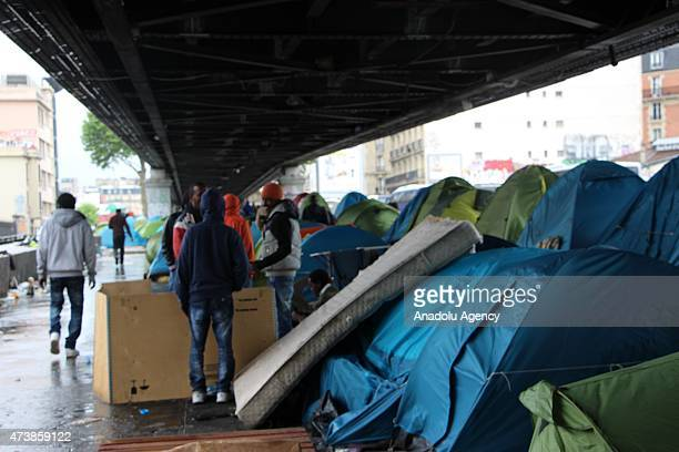 Around 300 migrants from Sudan Chad Ethiopia Eritrea and Syria hold on life in tents located under the bridge close to the city's Paris Nord Train...