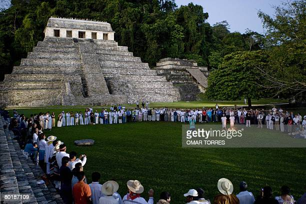 Around 300 people belonging to different ethnic groups take part in the Rising Sun ceremony in front of the Mayan Inscriptions' Palace at the...