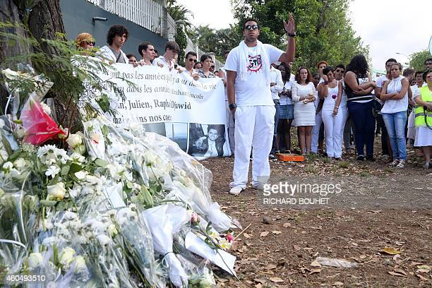 Around 400 people attend a march on December 15 2014 in SaintDenisdelaReunion on the French overseas island of La Reunion in homage to 5 students who...