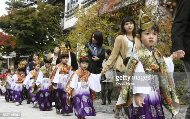 Around 50 children aged from four to six join the autumn festival at Daisenji a Buddhist temple in the town of Daisen in Tottori Prefecture western...