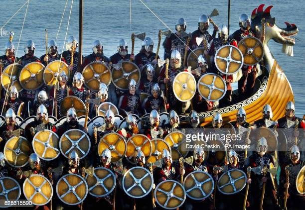 Around 50 men from the Norsemen Jarl Squad arrive at Lerwick harbour on a longboat to celebrate Shetland's annual Viking festival Up Helly Aa