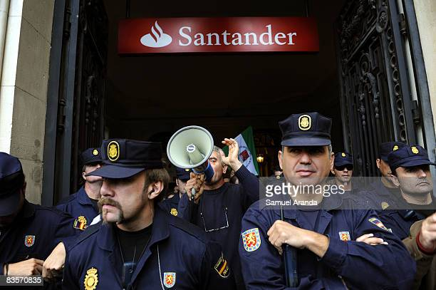Around 50 spanish farmers and workers are surrounded by police as they occupy the main office of the bank Santander on November 5 2008 in Seville...
