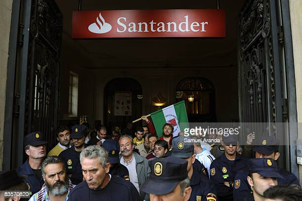 Around 50 spanish farmers and workers occupy the main office of the bank Santander on November 5 2008 in Seville Spain The protest was organised by...