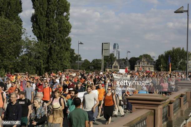 Around 800 protesters marched through Frankfurt to protest against the politics of the German government and the EU of closed borders and the...