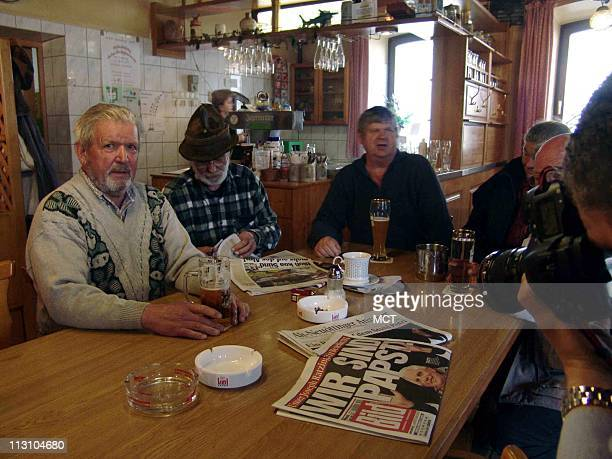 MARKTL GERMANY Around a stammtisch a daily lunchtime gathering around a long table in the Gasthof Oberbrau locals sit and debate politics soccer...