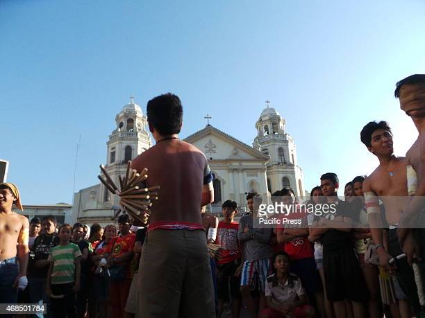 Around ten teens from Dagupan Tondo selfflagellates in front of Quiapo Church in Manila on Good Friday morning as part of their Lenten penitence