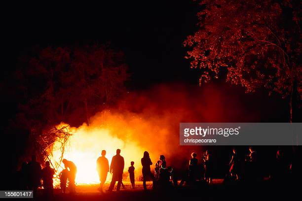 around the bonfire - bonfire stock photos and pictures