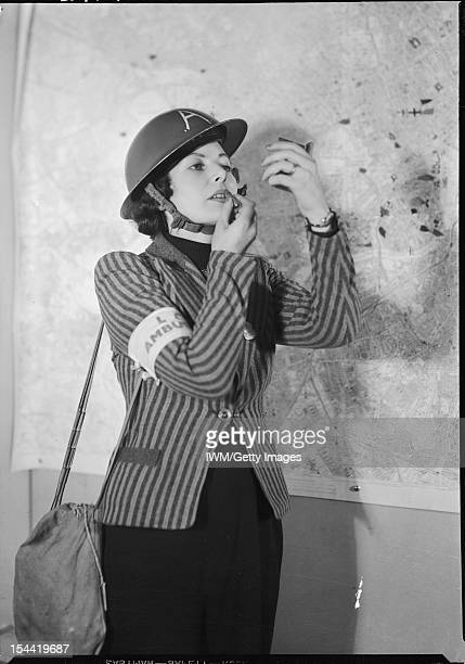Arp At Kingston House London c 1940 A female member of Air Raid Precautions staff applies her lipstick between emergency calls circa 1940